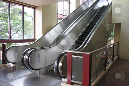 Steel escalators stock photo, Modern steel escalators pair side by side by Kheng Guan Toh