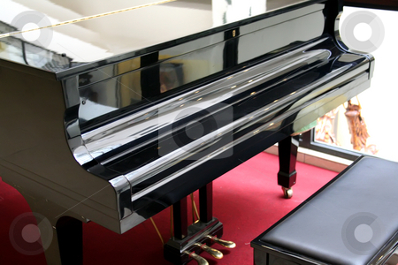 Grand piano stock photo, Black classical grand piano front view with seat by Kheng Guan Toh