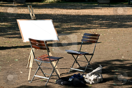 Blank easel stock photo, Blank easel with chairs outdoors on sunny day by Kheng Guan Toh