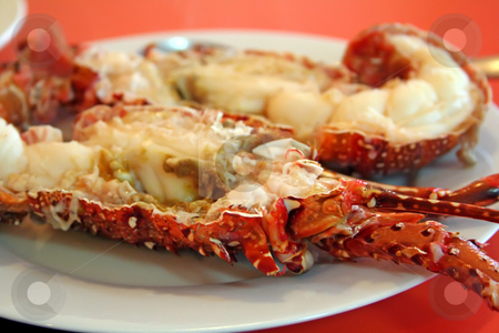 Split lobster stock photo, Cooked lobster split into halves on plate by Kheng Guan Toh