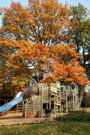 Autumn playground stock photo, Children's playground wooden playset autumn trees background by Kheng Guan Toh