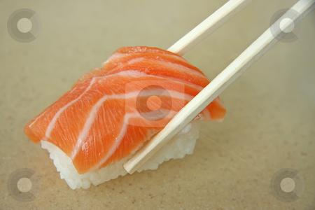 Salmon sushi stock photo, Salmon sushi held in chopsticks japanese cuisine by Kheng Guan Toh