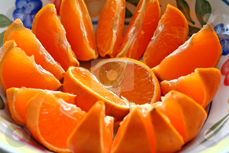 Sliced oranges stock photo, Sliced oranges arranged spread on a plate by Kheng Guan Toh