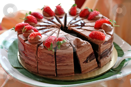 Chocolate cake stock photo, Chocolate cake with icing and strawberries sliced by Kheng Guan Toh