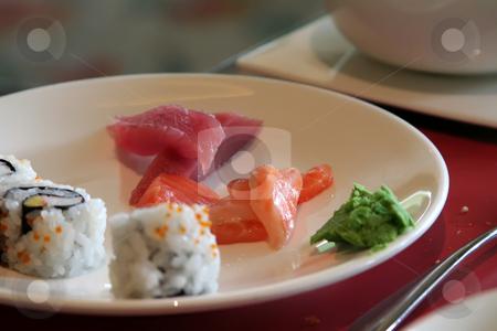 Sashimi sushi stock photo, Arrangement of sushi and sashimi in a restaurant setting by Kheng Guan Toh