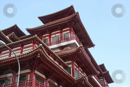 Traditional chinese temple stock photo, Architectural detail of  traditional chinese temple  rooftop against sky by Kheng Guan Toh