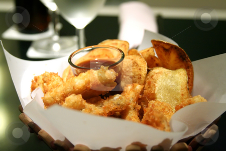 Snack basket stock photo, Snack basket of fried calamari and potato chips restaurant setting by Kheng Guan Toh