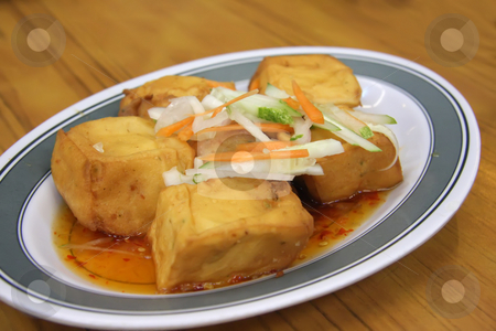 Fried tofu stock photo, Chinese cuisine dish of fried tofu in gravy by Kheng Guan Toh