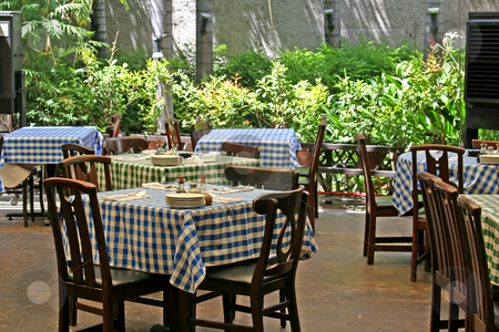 Italian restaurant stock photo, Outdoor italian restaurant with chairs and tables with checked tablecloths by Kheng Guan Toh