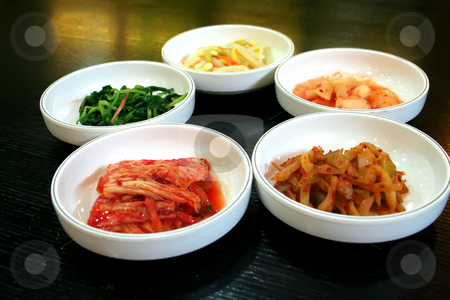 Bowls of kimchi stock photo, Bowls of Kimchi traditional Korean spicy vegetable pickles by Kheng Guan Toh