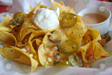 Mexican nachos stock photo, Nachos mexican snacks fried corn chips cuisine by Kheng Guan Toh