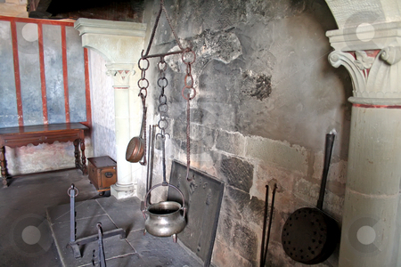 Fireplace kitchen stock photo, Antique kitchen in castle fireplace with old pots and pans by Kheng Guan Toh