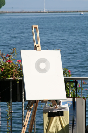 Lakeside easel stock photo, Blank artist easel with a view of summertime lake by Kheng Guan Toh