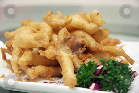 Fish nuggets stock photo, Batter fried golden fish nuggets in plate by Kheng Guan Toh