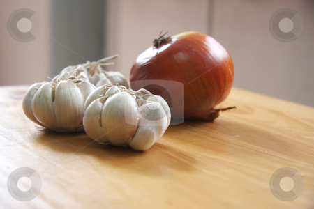 Onion and garlic stock photo, Whole entire raw onion and garlic cloves on wooden board by Kheng Guan Toh
