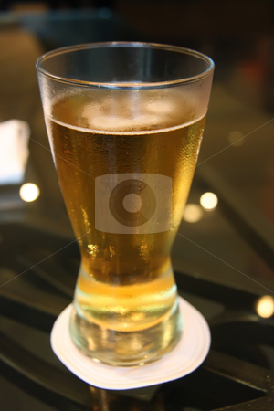 Glass of beer stock photo, Glass of beer on table with paper coaster by Kheng Guan Toh