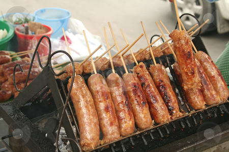 Thai sausages stock photo, Skewered vermicilli sausages tradtional thai street food by Kheng Guan Toh