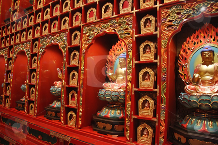 Buddha statues stock photo, Golden buddha statue display in chinese temple by Kheng Guan Toh