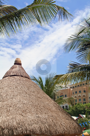Tropical hut stock photo, Thatched hut of a roof in a tropical resort by Kheng Guan Toh