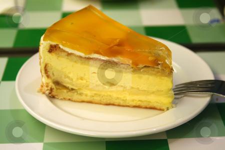 Mango cream cake stock photo, Mango cream cake on white plate restaurant setting by Kheng Guan Toh