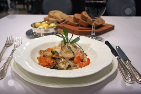 Seafood pasta stock photo, Seafood pasta served in luxury restaurant setting by Kheng Guan Toh