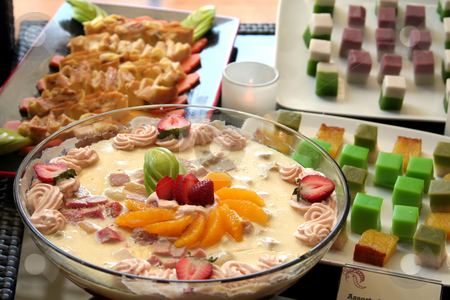 Fancy pudding stock photo, Fancy decorated pudding with cream and sliced fruits by Kheng Guan Toh