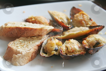 Baked mussels stock photo, Breaded baked mussels in shell white plate restaurant setting by Kheng Guan Toh