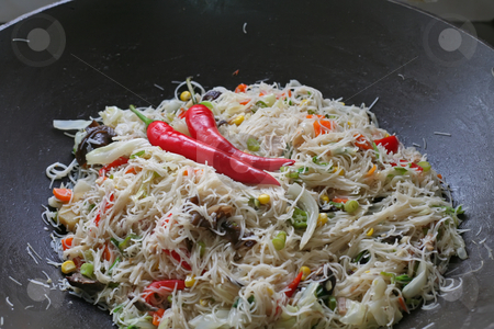 Asian fried noodles stock photo, Asian fried noodles prepared in wok with chillis by Kheng Guan Toh