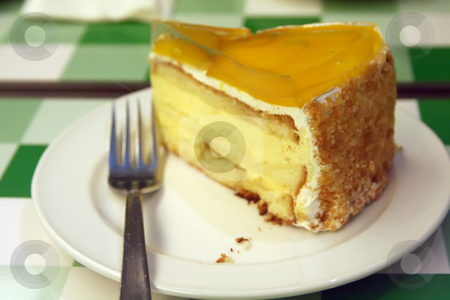 Mango cream cake stock photo, Mango cream cake on white plate restaurant setting by Kheng Guan Toh