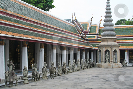 Temple of Dawn stock photo, Deity statuettes in the courtyard of the Temple of Dawn in Bangkok Thailand by Kheng Guan Toh