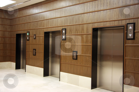 Modern elevators stock photo, Modern elevators with metal doors wood panelling by Kheng Guan Toh