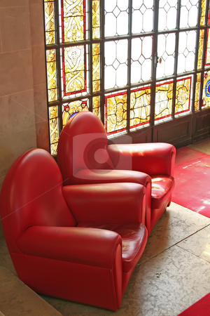 Sofas in waiting area with stained glass window stock photo, Sofas in waiting area with stained glass window by Kheng Guan Toh