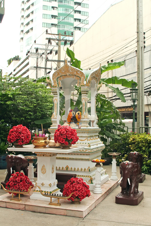 Buddhist city shrine stock photo, Small buddhist city shrine in the middle of Bangkok by Kheng Guan Toh