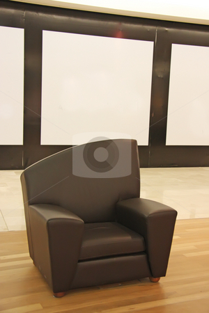 Black leather sofa stock photo, Black leather sofa chair with wooden floor by Kheng Guan Toh