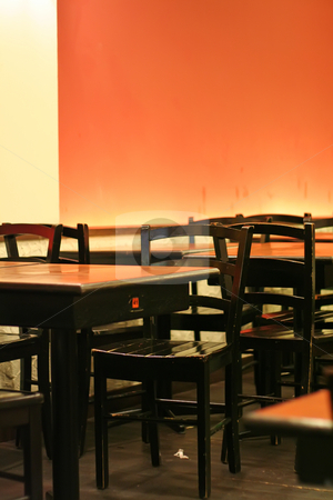Restaurant stock photo, Restaurant orange wall lighting tables and chairs by Kheng Guan Toh