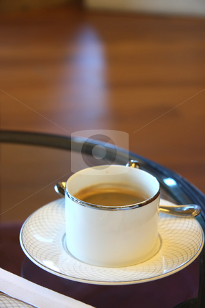 Cup of coffee stock photo, Cup of coffee in porcelein cup elegant setting by Kheng Guan Toh