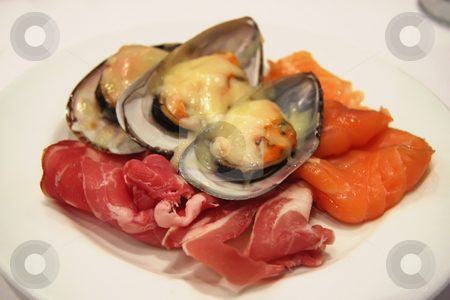 Appetizer plate stock photo, Appetizer plate of spanish ham smoked salmon and baked mussels by Kheng Guan Toh