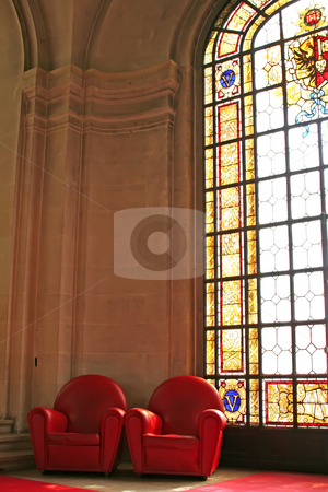 Sofas stained glass stock photo, Sofas in waiting area with stained glass window by Kheng Guan Toh