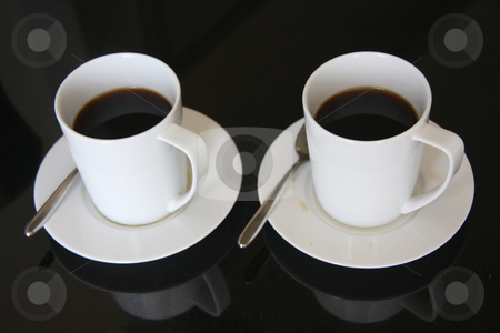 Black coffee stock photo, Two mugs of black coffee in white ceramic cups by Kheng Guan Toh