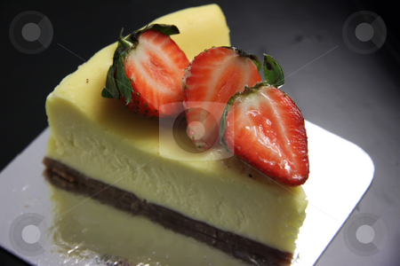 Cheesecake stock photo, Slice of cheesecake with cut strawberries on top by Kheng Guan Toh