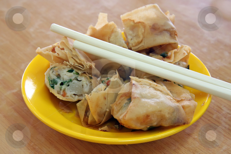 Fried dimsum stock photo, Fried dimsum in plate with chopsticks chinese food by Kheng Guan Toh