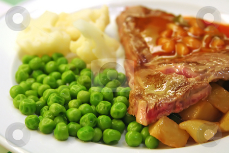 Pork chops stock photo, Pork chops with peas and potatoes restaurant setting by Kheng Guan Toh