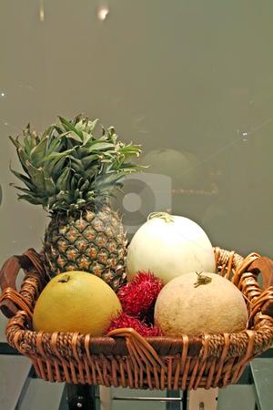 Tropical fruits stock photo, Basket of assorted tropical fruits pinapple melons rambutan by Kheng Guan Toh