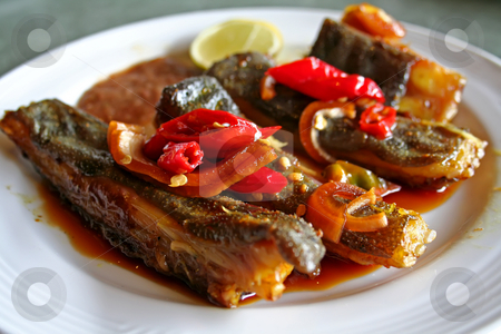 Grilled fish stock photo, Spicy grilled rayfish traditional asian cuisine on white plate by Kheng Guan Toh