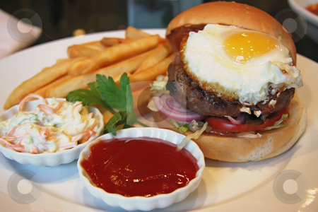 Egg burger stock photo, Fancy burger with fried egg and french fries by Kheng Guan Toh