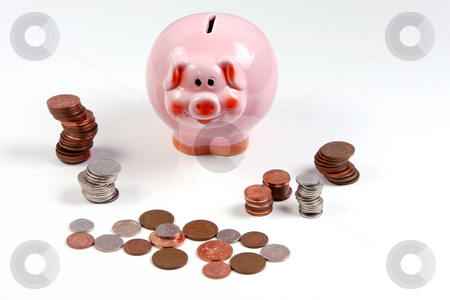 Pink Piggy Bank with coins / cash / money arranged around it stock photo, Pink piggy bank with money around it by Mark Allchin