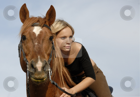 Teen and horse  stock photo, Blond teenager and her brown horse in blue sky by Bonzami Emmanuelle