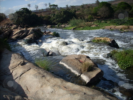 The Athi River - exposed boulders stock photo,  by Rose Nthiwa