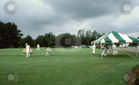 Croquet match stock photo, Setting up field for the game of croquet by Joseph Ligori