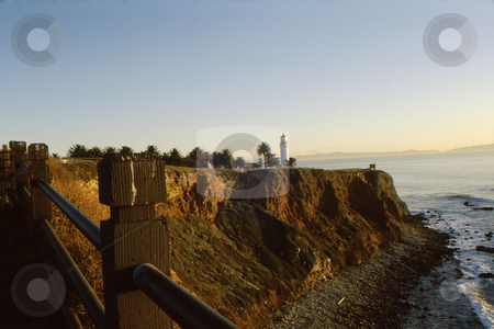 Costal Cliffs and lighthouse stock photo, Coastal cliffs with lighthouse at point by Joseph Ligori